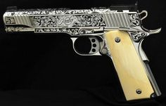 Custom Kimber 1911 with some white pearl grips, and this would be my DREAM gun.