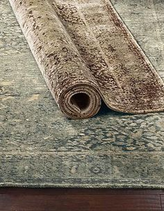 Warm any room in your home with the classic old-world design of the Colson Viscose Pile Rug that is available in two rich color designs.