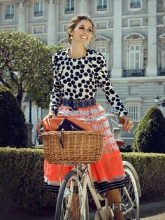 Oh so whimsical Olivia Palermo on a bicycle, wearing a printed top and skirt.  Pattern mixing. Print mixing.