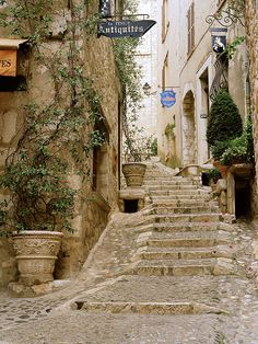 Saint Paul Stairs- Saint Paul de Vence (Provence), France  There is something so quaint and lovely about the pictures of the older streets in Europe. It looks like you've stepped into a time machine.