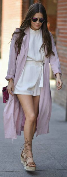 Paola Alberdi + rocking a super cute spring style + head to toe pastels + white wrap around playsuit + light and flirty + pair of strappy platforms + blush pink trench + endless glamour to the look!  Coat: Express, Playsuit: BB Dakota, Heels: Paloma Barcelo.
