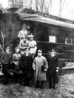 WWI:  The armistice is signed on 11 November 1918 between the French, English and Germans in a railway carriage at Compiègne, France.
