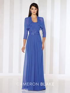 Two-piece chiffon dress set, strapless A-line gown with semi-sweetheart neckline, pleated bodice, lace appliqué at natural waist, flyaway skirt with side slit and sweep train. Matching bolero jacket with three-quarter length sleeves, shawl, and removable straps included. Sizes: 4 – 20 Colors: Royal Blue, Putty, Turquoise