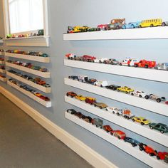 Super cute!  2x2 boards painted white with magnetic paint on the top.  Place all those little boy cars on the magnetic paint!