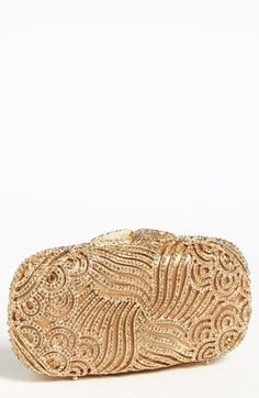 Tasha 'Crystal Swirl' Clutch available at #Nordstrom $298. Swirling crystals add dazzling depth to a compact clutch with a removable drop-in chain strap. Magnetic closure. Metal/crystal/polyester. By Tasha; imported.