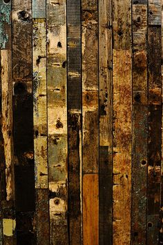 "so idea... doing a large wooden piece like this on the ""big"" wall in the living room. could use different types of lumber, distress the strips and stain them all different. and put them together. would be really pretty during christmas with a big wreath hanging in front of it.. :)"