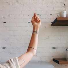 Accent your arms with minimally designed tattoos.