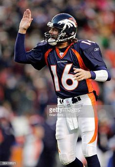 11fef6e8b61 Quarterback Jake Plummer of the Denver Broncos celebrates a touchdown  against the Baltimore Ravens in the