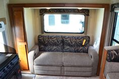 The Lance 1172 has a rear slide-out with a sofa.  Can you believe there's a sofa in a slide-in truck camper?