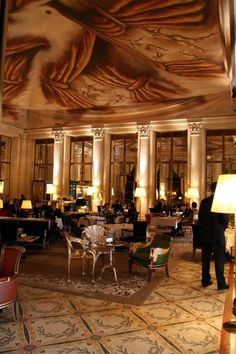 Meurice, Paris.... Le Dali lobby restaurant is named after the artist Salvador Dali who lived at the hotel for a time. Dali designed the two whimsical chairs, center left... amazing.