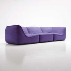 Modular sofa for indoor environments with removable cover, composed of central, corner and chaise longue elements. The structure, made of polyurethane..