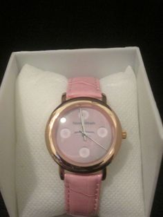 Noneillah's gold trim face pink leather band $36. When you purchase this watch a %'s will go to The Deshon Johnson College Scholarship Foundation.