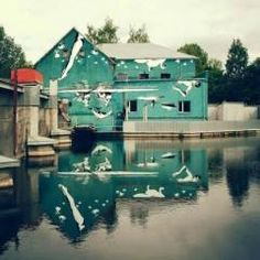 Upside down street art ~ This mural was painted upside-down to reflect off of the water. New York-based artist Ray Bartkus has created a beautiful mural in the Lithuanian city of Marijampolė designed to use the surface of the water as its true canvas. Reflection Art, Water Reflections, Street Art, Street Mural, Art Mural, Wall Murals, Art Festival, Public Art, Oeuvre D'art