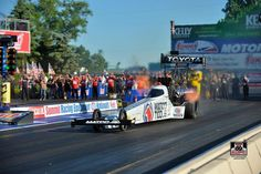 Driver of the Matco Tools T/F Dragster Antron Brown racing at Norwalk Ohio's Summit Nationals with team.