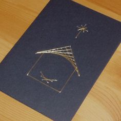 String art Card by Pop Up Zoo Greetings cards showing the manger and stable in gold thread. But you, O Bethlehem Ephrathah, are o...