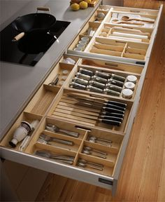 SANTOS kitchen | First level of the base area is used to store kitchen utensils. These drawers can be equipped with multiple combinations of removable accessories made in natural wood that make it easier to organise the most frequently used kitchen utensils. #kitchen #drawer #knife