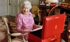To celebrate her new record reign, Buckingham Palace released a commemorative photo of Queen Elizabeth in her office.