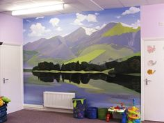 This mural features a Lake District landscape. The calming colours and beautiful scenery really open up the space.