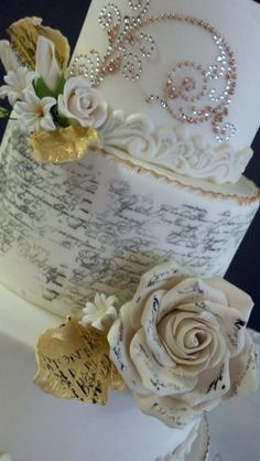 Close-up of the  Stamped love quotes with sugar paste flowers   ~ wedding Cake