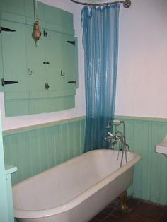 Bathroom with green shutters