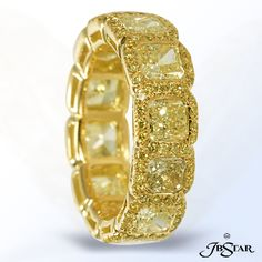 Style 2223 This stunning 18KY Eternity Ring features 12 hand selected Radiant Fancy Yellow Diamonds embraced by Fancy Yellow Pave. #yellowdiamondband #yellowdiamondeternityband #yellowdiamond