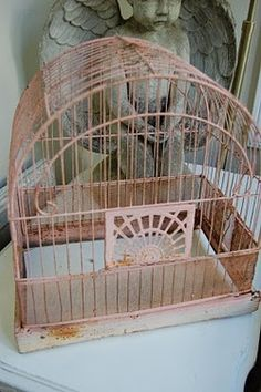 Vintage pink birdcage...we restored one like this for our pet Budgie, who had a 50 word vocabulary.
