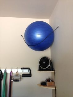17. Exercise Ball Storage: When you're working with limited space, every inch is crucial. Make your corners more efficient with a couple shelves and a DIY exercise ball storage solution using a bungee cord and nails. (via TrifDecor)