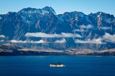 The TSS Earnslaw with the Remarkables mountain range in the background