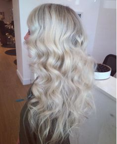 Bleached + toned platinum blonde waves. Hair by SALON by milk + honey stylist, Taylor G.