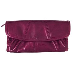 The Soft Wallet in fuchsia is has luxurious textured faux leather and a convenient magnetic closure!