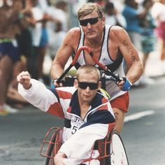Dick Hoyt has pushed his disabled son, Rick, in more than 1,000 races including marathons & triathalons.  Their story is inspiring!