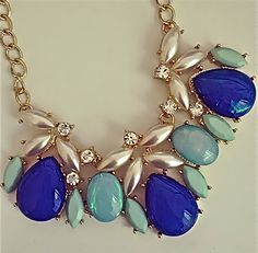 The outfit changing necklace . . . Shop www.popofchic.com