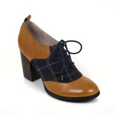 Man tailored for a feminie style.  This block heel gives a sense of refinement in a preppy way.