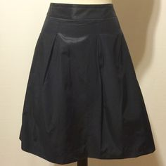 """BGBG Navy Pleated Short Skirt Classic navy skirt. Featuring a one and a half inch contour waist band, two side pockets, pleats at front and back. Fully lined, invisible side zipper.  56% cotton 44% rayon 55% poly, 45% viscose lining  Machine washable  32"""" waist 48"""" hips  60"""" sweep 20"""" overall length BCBGMaxAzria Skirts A-Line or Full"""