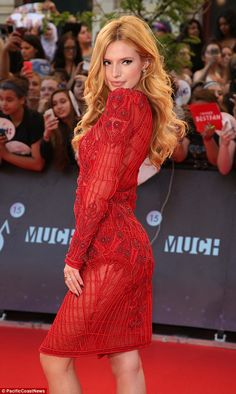 Making a statement: Bella looked amazing in her bright red dress with intricate lace embro... Bella looks absolutely stunning in her crimson.... #fashion #BellaThorne #movies