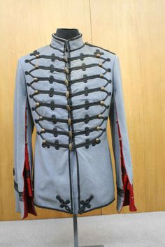 Ottoman military uniforms, Chevailiers jacket from the period of Sultan Abdulhamid II. With the establishment of the Janissary Corps members of the army began to wear a uniform. Initially caps were focused on rather than dress, these allowed soldiers to be distinguished from the public in peacetime and from enemy in wartime. With the extension of the countries borders and increase of the number of troops as a result,  different caps and dress were introduced for each service and region.