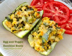 Use up all those zucchini with Egg and Veggie Zucchini Boats via Giggles, Gobbles and Gulps
