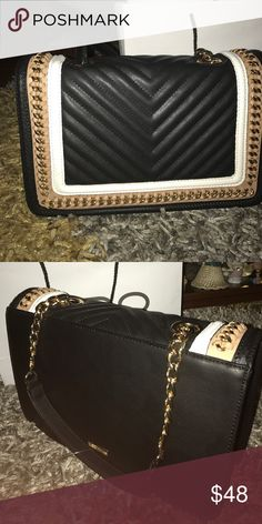 Multi way clutch bag perfect for any occasion Black white and cashmere cream, has a handle looks beautiful the perfect purse Aldo Bags Clutches & Wristlets