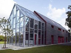 Sliding House - Suffolk, England   The 20-ton outer shell of this home can be retracted in six minutes, revealing a second, mostly glass, inner shell.