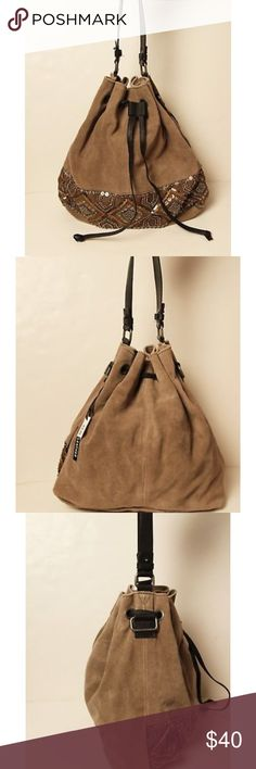 """Nine-Savannah Miller Draw String Leather&suede Nine- Savannah Miller Drawstring taupe leather and suede shoulder bag has beautiful gold and silver bead work. There's a small rip at the bottom of the bag(this can be repaired), with a little piece of tag adhered to the bottom (can be removed ).It has 2 interior pocket, and 1 zip wall pocket. Measurements: 16""""L x 16""""W x 5 1/2"""" D Strap- 14 1/2""""  NEW WITH DEFECT Nine- Savannah Miller Bags Shoulder Bags"""