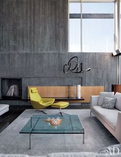In an ultramodern home on Washington's Mercer Island, Seattle architect Eric Cobb added rhythm and texture to the living room walls with plank-molded concrete | archdigest.com