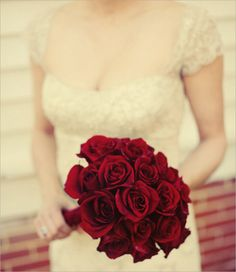 There are few things that can even begin to hold a candle to the beauty of a scarlet hued bouquet of roses.