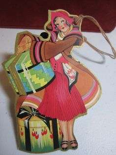 Art Deco 1920's-30's gold gilded die cut unused easter bridge tally card deco bobbed hair lady in colorful outfit holding a deco hat box.