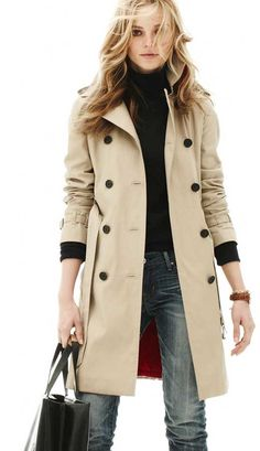 Trench coat with black buttons, black turtleneck and jeans