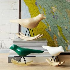Carved out of solid acacia wood, our Rocking Birds perch on a mid-century-inspired rocking base.