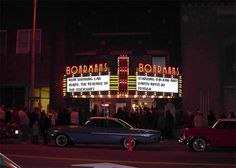 Classic cinema frontage with neon logo