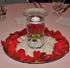 Love this centerpiece with the floating candle over the rose