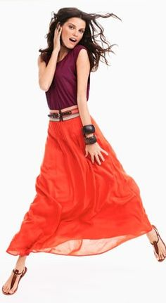 coral skirt, plum T, belt, and chunky cuffs