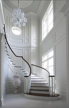Unbelievable white entry foyer and curved staircase, fabulous trim