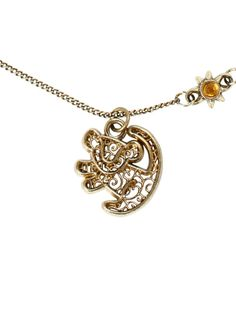 Gold tone necklace from Disney's The Lion King with filigree Simba pendant design.